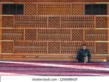MEDINA, SAUDI ARABIA-CIRCA 2016: Unidentified man read Koran inside Quba mosque in Madinah, Kingdom Saudi Arabia.