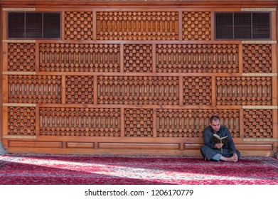 MEDINA, SAUDI ARABIA-CIRCA 2016: Unidentified man reads Koran inside Quba mosque in Madinah, Kingdom Saudi Arabia.