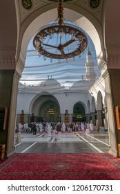 MEDINA, SAUDI ARABIA-CIRCA 2016:Unidentified Muslim men pray and rest inside Quba mosque in Medina, Saudi Arabia.