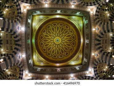 MEDINA, SAUDI ARABIA-CIRCA MAY 2015: Close up view of the glowing dome inside of Nabawi Mosque at night on MAY, 2015 in Medina, Saudi Arabia. The Mosque is the 2nd holiest mosque in Islam