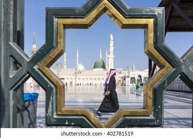 MEDINA, SAUDI ARABIA-DECEMBER 18, 2014: Unidentified Arab muslim walks on the compound of Nabawi Masjid (mosque) in Medina, Kingdom of Saudi Arabia.