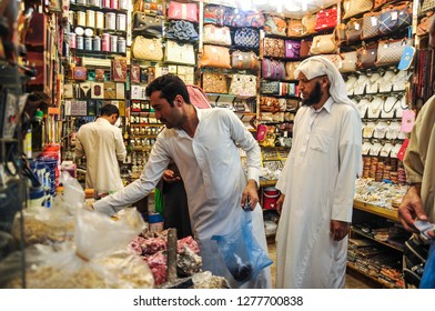 MEDINA, SAUDI ARABIA-July, 2016: Unidentified Muslim shop keeper selling various types of dates and other dried food.