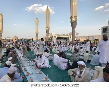 MEDINA, SAUDI ARABIA-MAY 25, 2019 : Muslims wait for iftar (breaking of fast) at the compound of Nabawi mosque (masjid). These foods and drinks were given free by anonymous individuals.