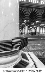 MEDINA-MAR 08 : A stack of Quran inside of Masjid Nabawi March 08, 2015 in Medina, Saudi Arabia. Nabawi Mosque is the second holiest mosque in Islam