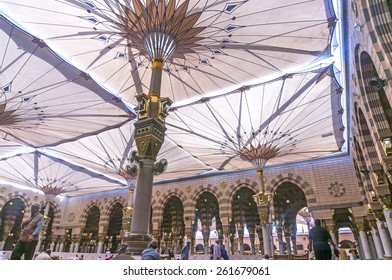 MEDINA-MAR 08:Muslims rest and pray inside of Masjid Nabawi March 08, 2015 in Medina, Saudi Arabia. Nabawi Mosque is the second holiest mosque in Islam and here is Prophet Muhammad is laid to rest