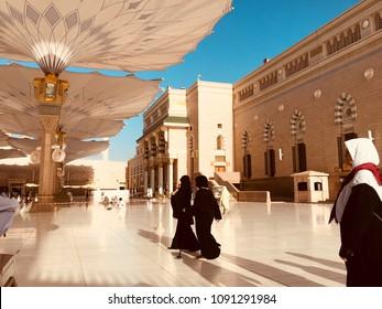 MEDINA,SAUI ARABIA-APRIL 9,2017:Unidentfied Arab muslim walks on the compound of Nabawi Masjid (mosque)in Medina,Kingdom of Saudi Arabia