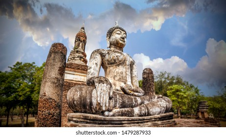 Meditating Buddha on the background of the temple and beautiful sky. Wat Traphang Ngoen at Sukhothai Historical Park, a UNESCO World Heritage Site in Thailand
