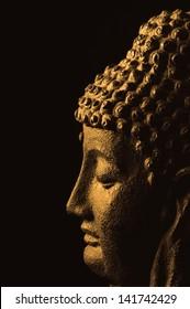 meditating buddha on black background