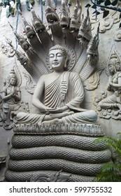 Meditating Buddha Statue on the wall. Vietnam