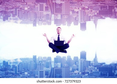 Meditating businessman on abstract upside down rainbow city background. Relaxation  concept