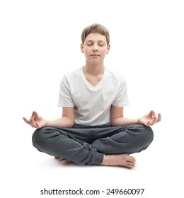 Meditating caucasian 12 years old childen boy in a white t-shirt, composition isolated over the white background