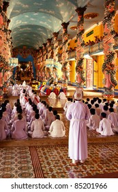 Meditating followers of the Cao Dai religion in the temple Cao Dai, South Vietnam
