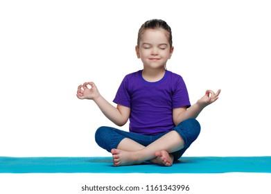 Meditating little girl isolated on white