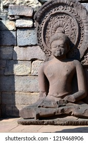 Meditating seated Buddha statue at the Gupta temple in Sanchi Stupa Complex which is a Buddhist complex, famous for its Great Stupa, on a hilltop at Sanchi Town in Raisen District near Bhopal.