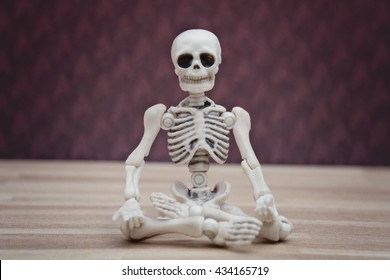 Meditating skeleton