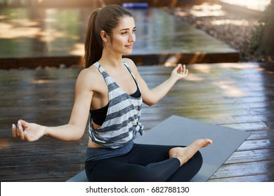 Meditating is a smart idea. Girl practicing yoga in the beggining of her workday away from technology.