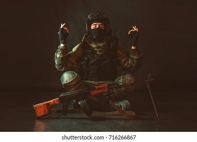 Meditating soldier. Airsoft.