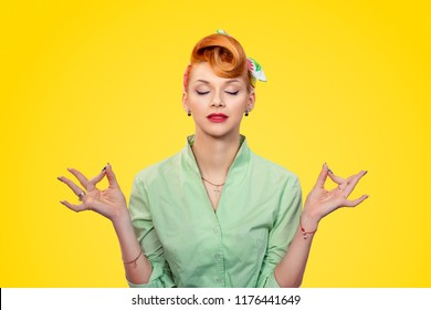 Meditation. Closeup red head young Business woman pretty pinup girl green button shirt meditating with eyes closed isolated yellow background retro vintage 50's style. Human emotions body language
