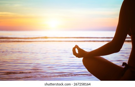meditation concept, yoga practice on the beach at sunset