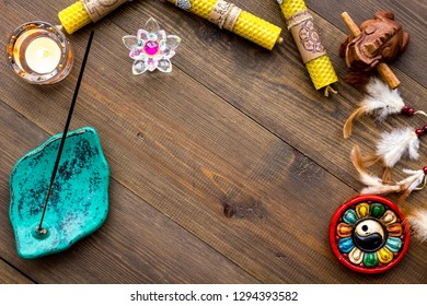 Meditation and eastern spiritual practices concept. Dark wooden background top view mockup