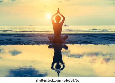 Meditation girl on the sea during sunset. Yoga silhouette. Healthy lifestyle. - Shutterstock ID 546838765