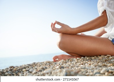 Meditation in lotus position on the beach.