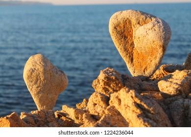 Meditation on the beach, balancing  stones meditation