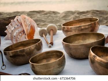 Meditation on the beach with Tibetan Singing bowls, Koshii and Tibetan tingshas. Balance and harmony.
