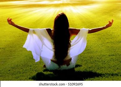 Meditation on a green field in solar beams