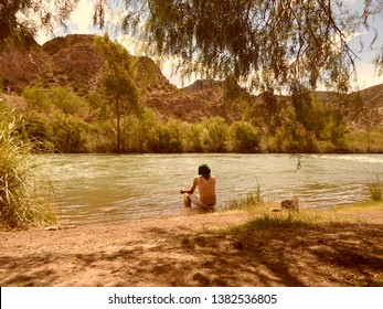 Meditation in river within Andes mountains
