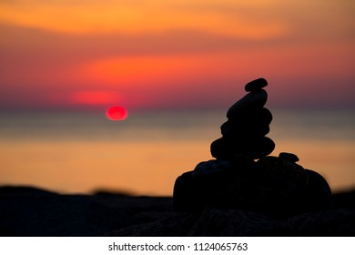 Meditation stones by sunrise in Oak Bluffs in Martha's Vineyard