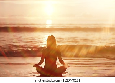 meditation and yoga on the beach / summer vacation concept health beauty, summer vacation yoga classes on the sea shore
