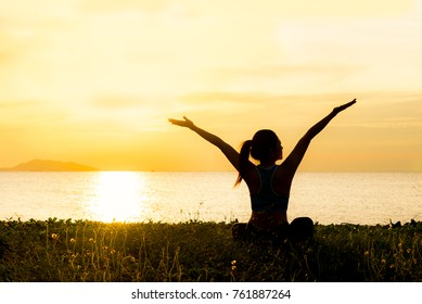 Meditation yoga spirit lifestyle happy mind body woman peace vitality, silhouette outdoors on the Sea sunrise, relax vital spirit abstract.  Healthy Concept.