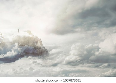 Meditative hiker enjoys the view from the top of the mountain