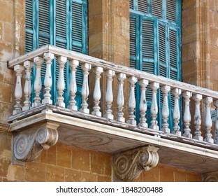 Mediterran balcon and old vintage tourquise windows