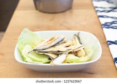 Mediterranean anchovy fish mezze on wood