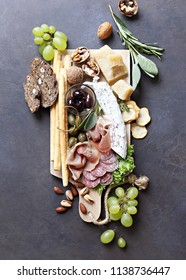 Mediterranean appetizers. Platter with tapas selection: jamon, cheese, olives and nuts.   Overhead view, copy space.