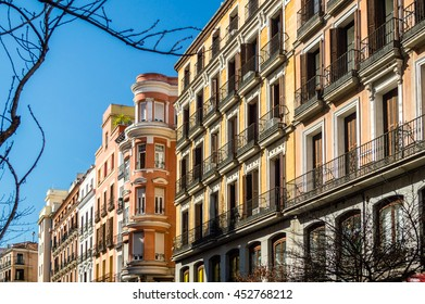Mediterranean architecture in Spain. Old apartment buildings in famous Calle Mayor in Madrid.