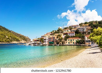 Mediterranean architecture and turquoise Ionian sea in Assos village, Kefalonia island, Greece.