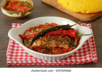 Mediterranean baked fish fillets with tomato sauce and hot peppers