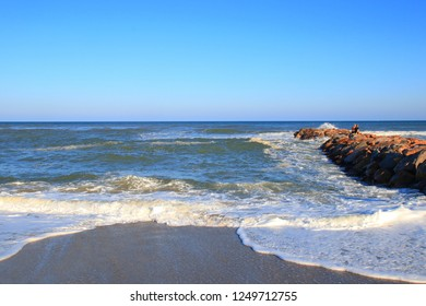 Mediterranean beach and dam with swell in Pyrenees orientales, Roussillon region of France