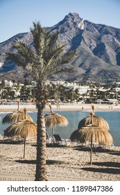 The mediterranean beach of Puerto Banus, Marbella, with La Concha peak in the background