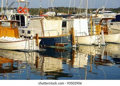 Mediterranean boats on the pier of Porto Colom in Majorca (Spain)