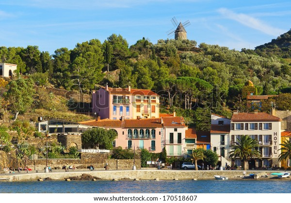 Mediterranean coast in Collioure village with hotel restaurant and a windmill at the top of the hill, Roussillon, Vermilion coast, Pyrenees Orientales, France