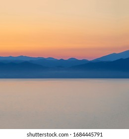 The Mediterranean coast of Italy at dawn as a colourful background abstract
