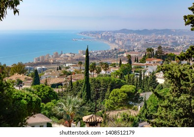 Mediterranean coastline with villas from Benalmadena, port of Fuengirola in background, Andalusia, Spain.