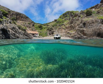 Mediterranean cove with a fishermen hut and neptune grass underwater sea, split view above and below water surface, Cap de Creus, Spain, Costa Brava, Catalonia, Cala Gentil
