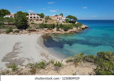 Mediterranean cove with a sandy beach and houses on the Costa Dorada in Spain, Cala Estany Tort, Catalonia, L'Ametlla de Mar, Tarragona
