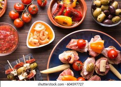 Mediterranean cuisine. Spanish tapas starters on wooden table. Top view
