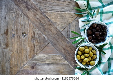 Mediterranean food background. Wooden table with checkered tablecloth and olives